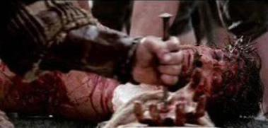A metal nail is driven through the hand of Jesus as he is nailed to the cross. From the film The Passion of the Christ