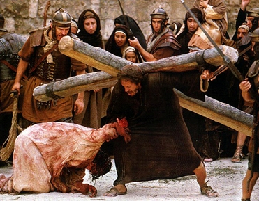 Jesus falls and is helped by Simon of Cyrene, from the film Passion of the Christ