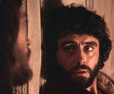 Judas looks at Jesus, scene from a film of the Life of Jesus