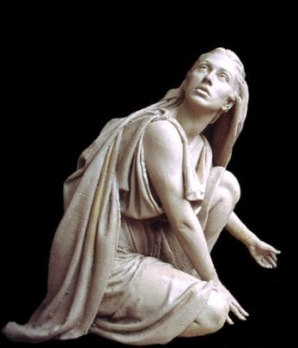 Statue of Mary Magdalene looking upwards towards Jesus