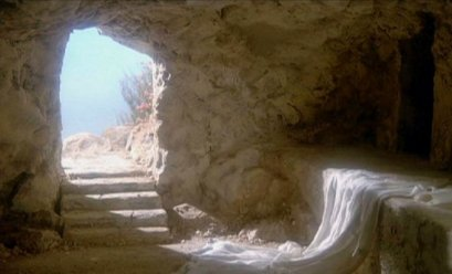 The empty tomb of Jesus, with discarded shroud lying on a stone bench