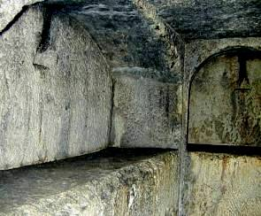 Underground stone tombs from the Tombs of the Kings in Jerusalem. Notice the stone slabs which held the bodies of the dead.